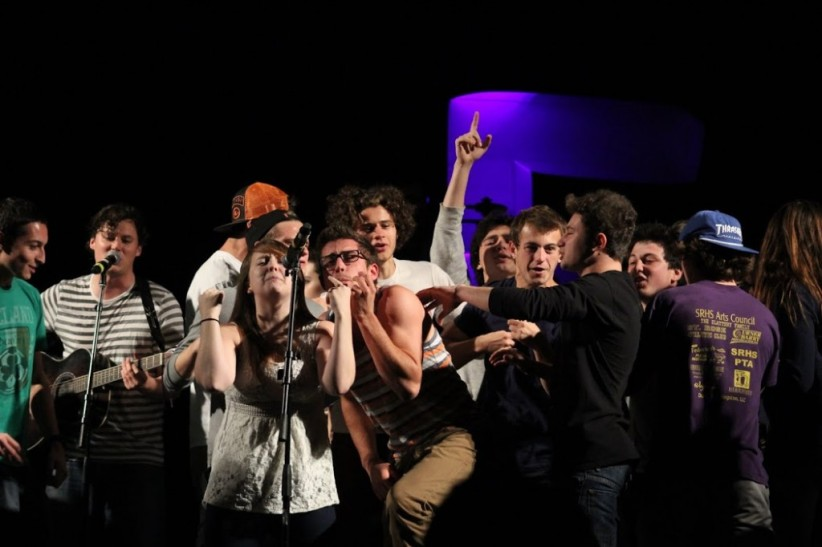 Students storm the stage during a lively performance from The Front Bottoms. (Michael Cort / The Signal Photo Assistant)