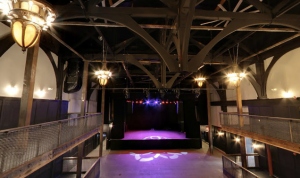 The stage at Union Transfer sits beneath metal trusses and chandeliers. (Photo courtesy of Google Maps)